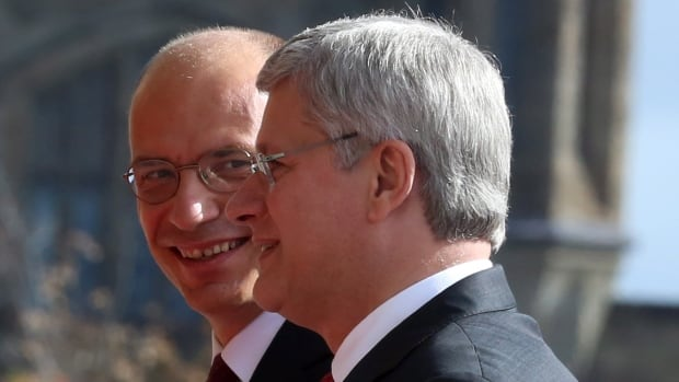 Italian Prime Minister Enrico Letta, left, chats with Prime Minister Stephen Harper as he arrives on Parliament Hill Monday for meetings in his first official visit to Canada.