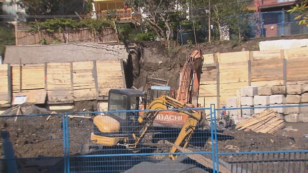 A 34-year-old construction worker is in critical condition after a landslide crushed him at a Westmount job site.