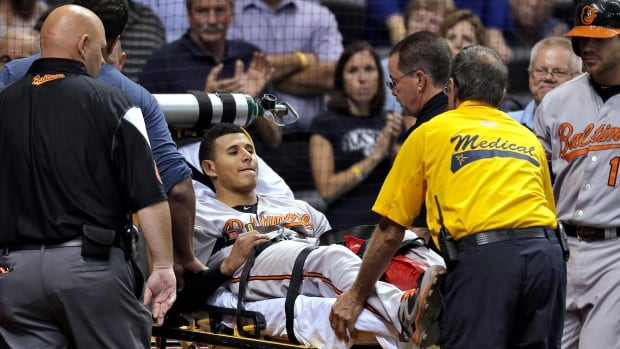 Baltimore Orioles third baseman Manny Machado is taken off the field on a stretcher after injuring his left leg while running to first base on a seventh-inning single on Monday in St. Petersburg, Fla.