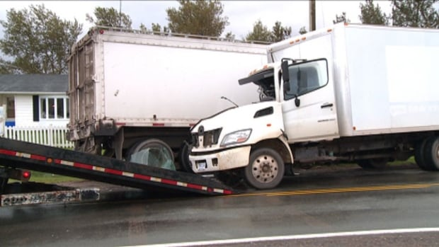 The cab of one of the trucks was badly damaged, but both truck drivers were able to walk away.