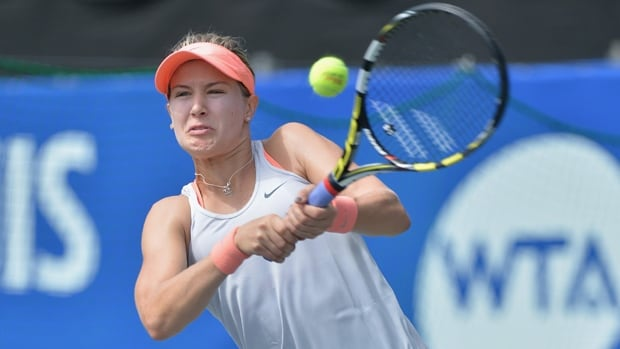 Eugenie Bouchard of Westmount, Que., hits a return in Tuesday's 5-7, 7-6, 6-3 triumph at Tokyo.