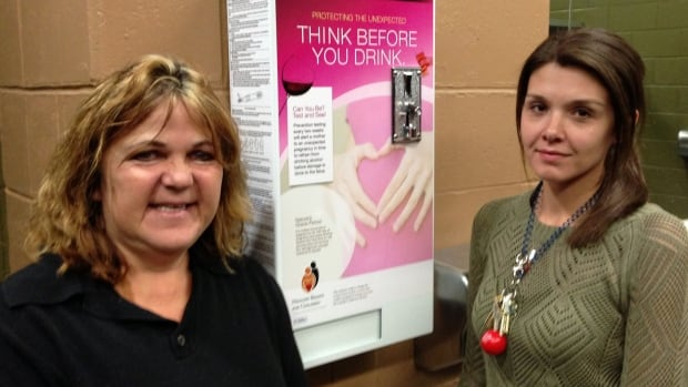 Marilyn Leiterman, left, chair of Thunder Bay's Healthy Brains for Children chapter, and Charmaine Romaniuk, of the Lakehead University Student Union, will officially unveil the campus bar's pregnancy test dispenser at a news conference Tuesday afternoon.
