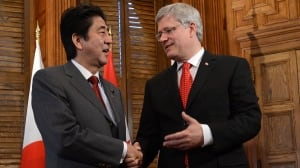 Prime Minister Stephen Harper, right, greets Japanese Prime Minister Shinzo Abe in his office on Parliament Hill on Tuesday. The two talked about this week's opening of the UN General Assembly and about shared interests around energy and security.