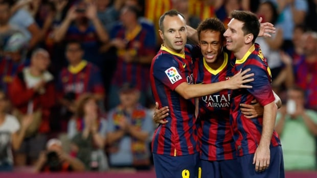 Barcelona's Neymar, centre, Lionel Messi, right, and Andres Iniesta celebrate a goal against Real Sociedad on Tuesday.
