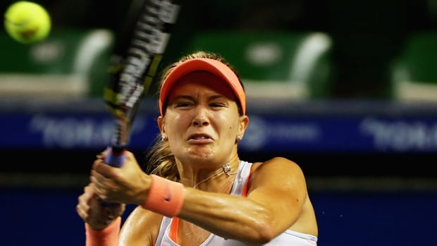 Eugenie Bouchard of Westmount, Que., hits a return in Wednesday's 7-6, 6-2 triumph at Tokyo.