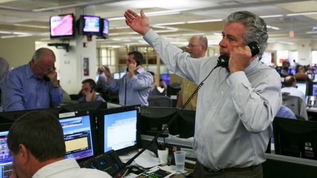 Brokers work on the trading desk at an ICAP PLC office in Jersey City, N.J., in March 2008. The firm, which is based in London, is the world's largest inter-dealer broker and has agreed to pay $87 million US to settle charges that it manipulated a key inter-bank interest rate.