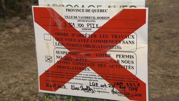 The provincial government issued a notice of non-conformity to A Vaudreuil land developer who has been pumping water out of a quarry-lake.
