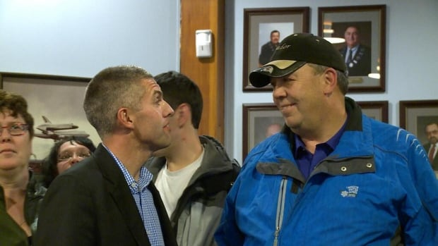 Jamie Snook, left, was elected as the new mayor for Happy Valley-Goose Bay on Tuesday night. His main competition for the role, John Hickey, congratulates him.