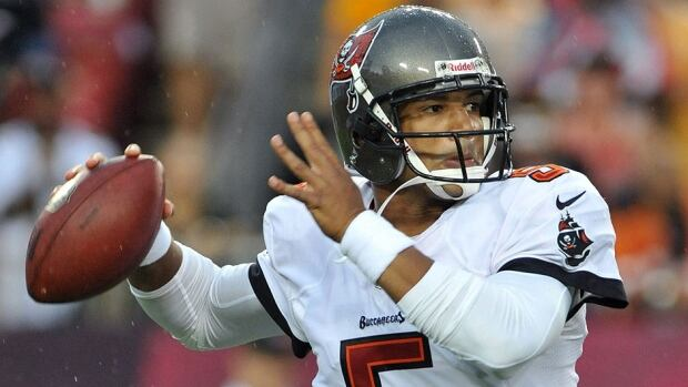 Buccaneers quarterback Josh Freeman, seen here, will give way to Mike Glennon this Sunday against Arizona. Freeman's completion percentage and quarterback rating (59.3) are last in the NFL this season.
