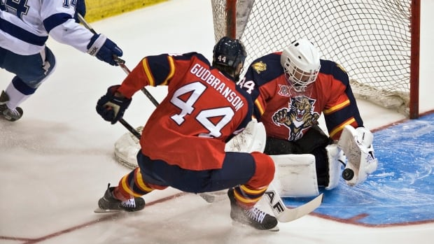 Florida Panthers goalie Tim Thomas, right, has played in 378 NHL games, all with Boston .