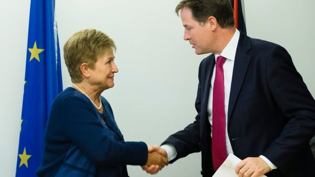 Deputy Prime Minister of the United Kingdom Nick Clegg, right, and European Union Commissioner Kristalina Georgieva shake hands following a news conference during the 68th session of the United Nations General Assembly.