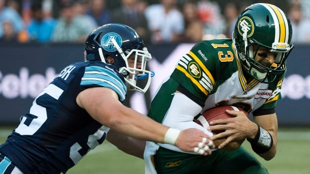 Edmonton Eskimos quarterback Mike Reilly, right, and his club are hoping they can take down the 8-4 Toronto Argonauts on Saturday night.