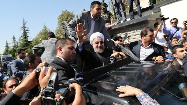 President Hassan Rouhani waves to supporters as his motorcade leaves Tehran's Mehrabad Airport upon his arrival from New York.