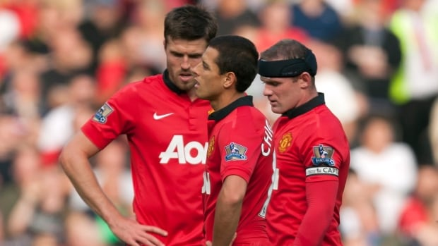 Manchester United's Wayne Rooney, right, Javier Hernandez, centre and Michael Carrick find themselves in the bottom half of the Premier League standings.