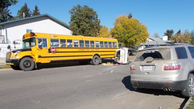 RCMP say distracted driving was the cause of an SUV roll-over in Lloydminster Friday morning.
