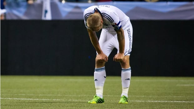Vancouver Whitecaps' captain Jay DeMerit hangs his head after losing 1-0 to Real Salt Lake on Saturday.