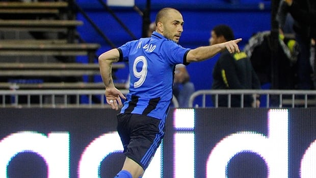 Marco Di Vaio of Montreal Impact celebrates a goal against the Toronto FC at the Olympic Stadium on March 16, 2013 in Montreal.