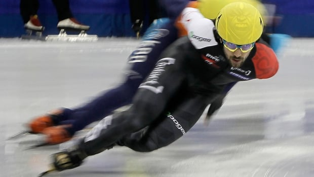 Canada's Charles Hamelin, front, competes to win the men's 1000m final at the ISU Short Track World Cup in Shanghai on Sunday.