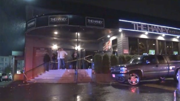 Police tape blocks off the entrance to the Haney Public House in Maple Ridge, B.C.