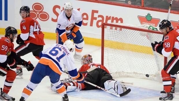 New York Islanders' Riley Wetmore scores past Ottawa Senators' Craig Anderson in Ottawa on Sunday, Sept. 29, 2013.