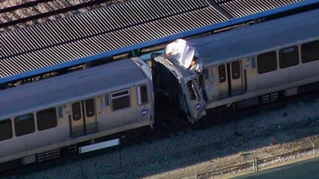 This image from video provided by NBC Chicago shows the aftermath of a crash involving two Chicago Transit Authority trains on the Blue Line during rush hour Monday morning. The head-on collision happened on Sept. 30, 2013, in Chicago's Forest Park area. Up to 48 people are reported to have been sent to hospital. (NBC Chicago/AP)