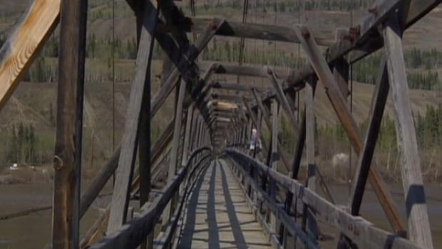 Government officials say the deck of the suspension bridge at Ross River, Yukon, will be removed to help assess the integrity of the steel towers.