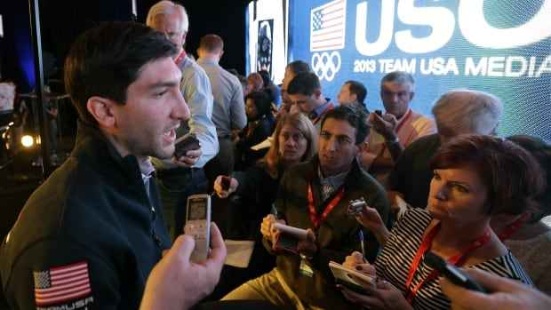 Olympic figure skating champion Evan Lysacek makes remarks during a press conference on Monday, where he confirmed he'll miss October's Skate America event.