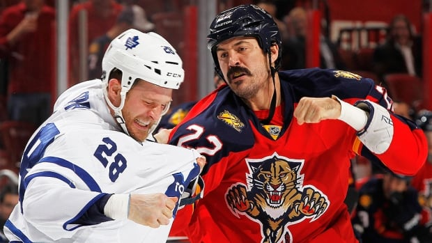 With Maple Leafs tough guy Frazer McLaren out with a broken finger, some are making wagers on how long it will take Canadiens newcomer George Parros, right, to tangle with Toronto enforcer Colton Orr, left, in the season opener for both clubs Tuesday night.