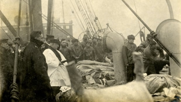 This haunting photo shows the bodies of Titanic victims stacked on a boat deck before burial. The photo will be auctioned off.