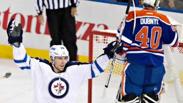 The Winnipeg Jets' Blake Wheeler celebrates a goal against Edmonton Oilers goalie Devan Dubnyk during the first period in Edmonton on Tuesday. The Jets won 5-4.
