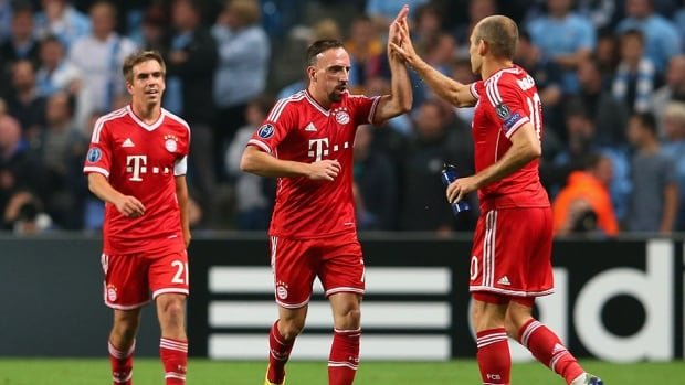 Franck Ribery celebrates with Arjen Robben after he scored a goal for Bayern Munich against Manchester City at Etihad Stadium on October 2, 2013 in Manchester, England.