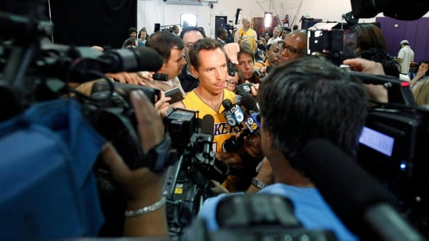 Los Angeles Lakers guard Steve Nash, centre, talks to reporters during media day Saturday.
