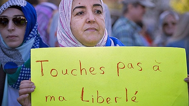 A Quebec woman wearing a hijab takes part in one of the many protests both for and against the proposed values charter. Each of the past three weekends has seen one side or the other take to the streets of Montreal to show their displeasure/support of the PQ plan.
