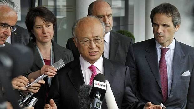 Yukiya Amano, centre, director general of the International Atomic Energy Agency, speaks to the media at Vienna International Airport after returning from Iran Tuesday. Amano said he has reached a deal with Iran on probing suspected work on nuclear weapons and added that the agreement will be signed quite soon.