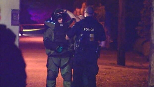 A member of the RCMP bomb squad speaks to a Delta Police officer prior to the detonation Monday night in Tsawwassen.