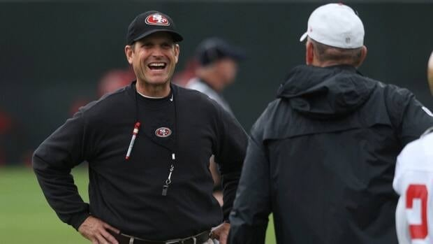 San Francisco coach Jim Harbaugh, left, oversees practice at 49ers headquarters in Santa Clara, Calif. on Friday, Nov. 16, 2012.