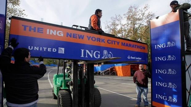 Workers assemble the finish line for the New York City Marathon in New York's Central Park, Thursday, Nov. 1, 2012. The 43rd New York City Marathon was cancelled on Friday.