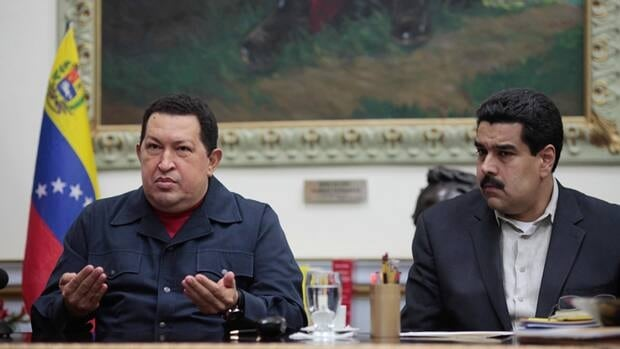 Venezuela's President Hugo Chavez , left, speaks beside Vice-President Nicolas during a televised speech on Saturday. Chavez announced that his cancer has returned and that he will undergo another surgery in Cuba.
