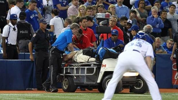 Paramedics stop the game to try and revive a man of an apparent heart attack during MLB action at the Rogers Centre on Thursday.