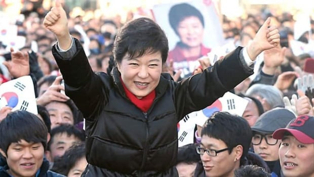 Park Geun-hye raises her arms during her presidential election campaign in Busan, South Korea, on Dec. 18.