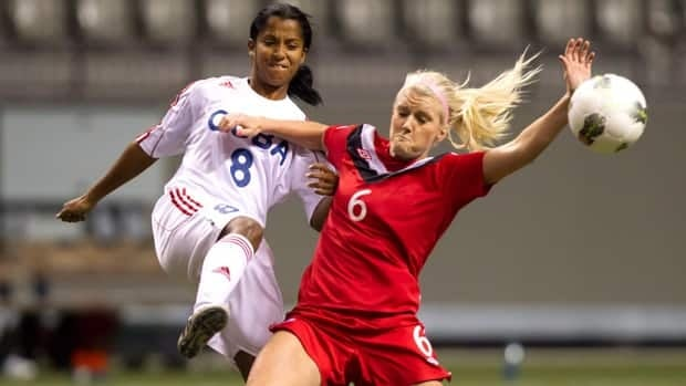Cuba's Yesenia Gallardo, left, is one of two Cuban players absent from their team's game against Haiti on Monday in Vancouver.