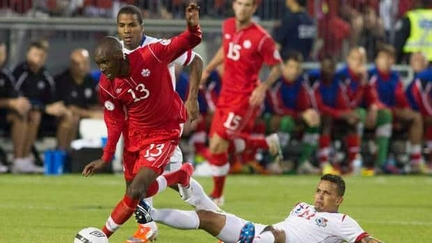 Atiba Hutchinson, left, was named Canadian male player of the year after battling back from injuries to lead PSV Eindhoven in the Netherlands.