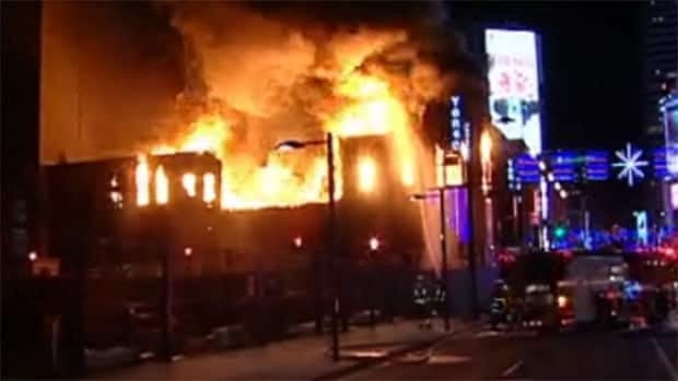 Toronto police have made an arrest in connection with the fire that occurred at the corner of Yonge and Gould streets on Jan. 3, 2011.