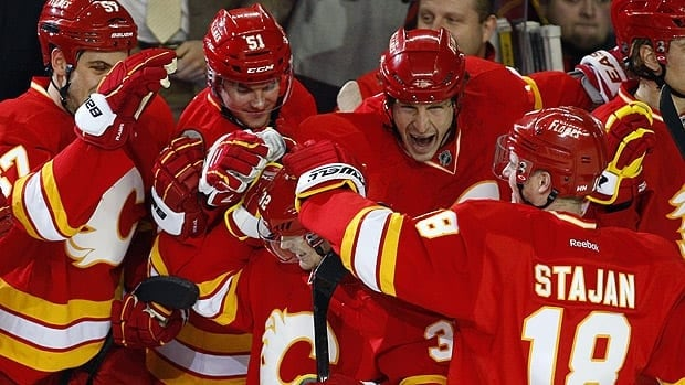 Paul Byron, centre, gets congratulated after scoring on a penalty shot in the second round for Calgary.