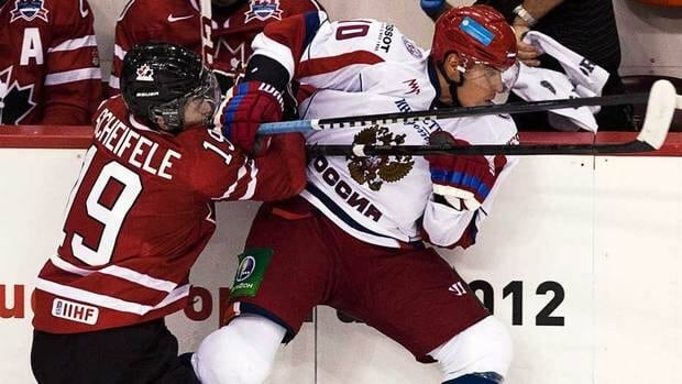 Canada's Mark Scheifele, left, checks Russia's Nail Yakupov in third period action in the Canada-Russia junior hockey challenge in Halifax on Monday.