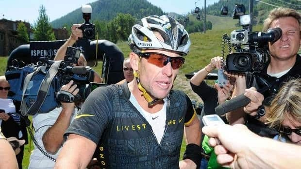 Lance Armstrong speaks to reporters after finishing the Power of Four Mountain Bike Race on Aspen Mountain on Saturday in Aspen, Colorado.