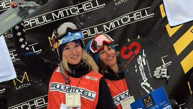 Canadians Dominique Maltais, left, and Maelle Ricker, right, celebrate a 1-2 finish at the snowboard cross World Cup event in Telluride, Colo.