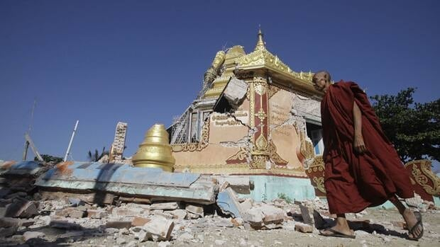 A Buddhist monk walks in front of damaged pagoda in Thabeik Kyin township on Monday. A magnitude 6.8 earthquake struck the region early on Sunday struck.