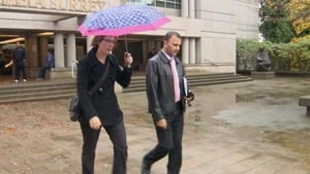 RCMP Major Crimes officers Cpl. Kathy Bullock and Sgt. David Chauhan, who led the search of Wakefield's home, leave court Monday.