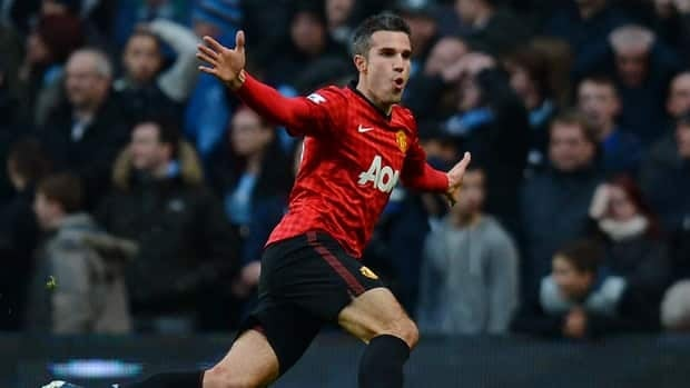 Manchester United's Robin van Persie celebrates scoring his goal in against Manchester City at Etihad Stadium in Manchester, England on December 9, 2012.